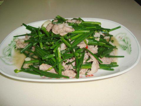 韭菜花炒猪肉怎么炒
